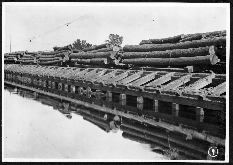 S. P. 306 Backside Log Cars Along Mill Pond Loading Dock