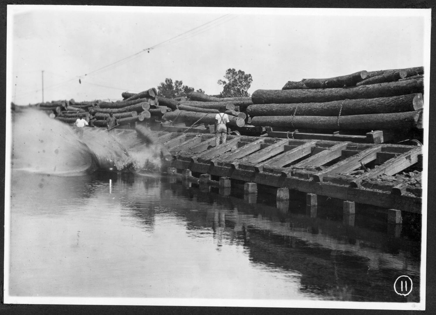 S. P. 308 Backside Unloading Logs into the Mill Pond