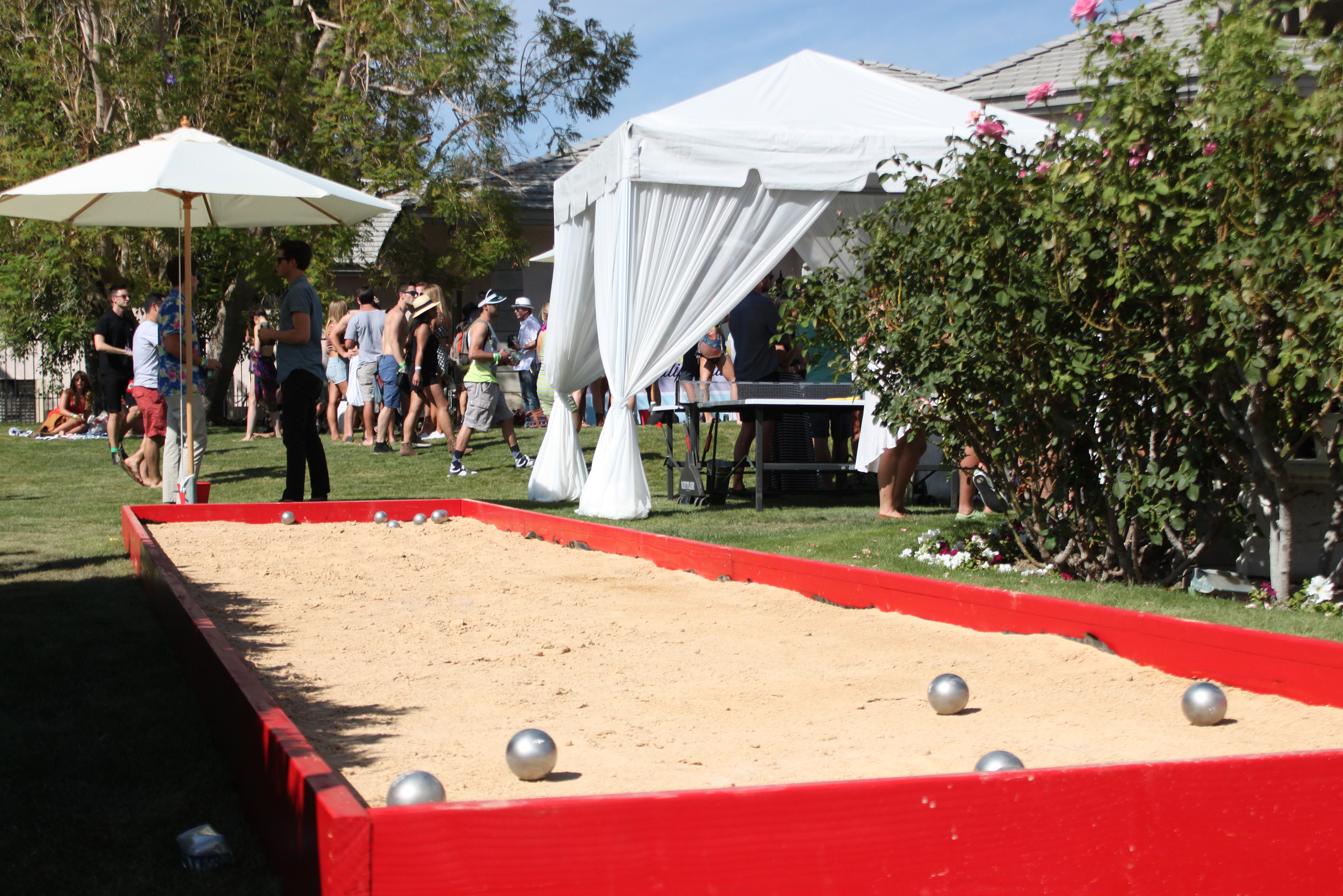 A sandy game of bocce ball