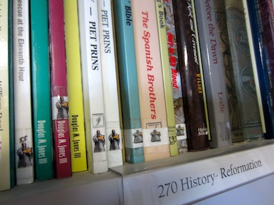 Books with Labels on Shelf.JPG