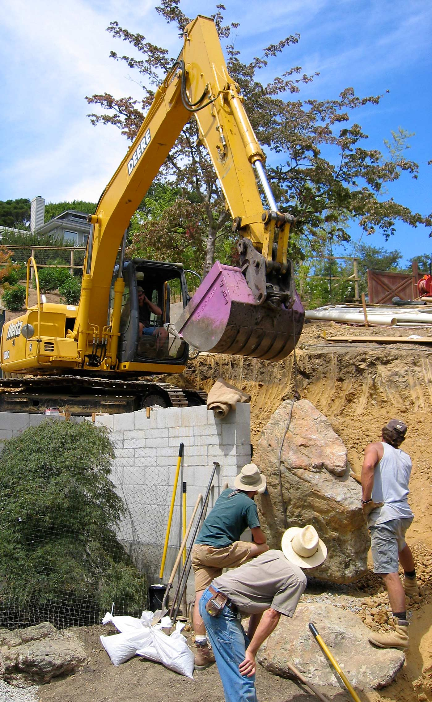 Setting a good sized boulder in Marin County, California. Look carefully, and you'll see this boulder in the above depiction of the finished garden.