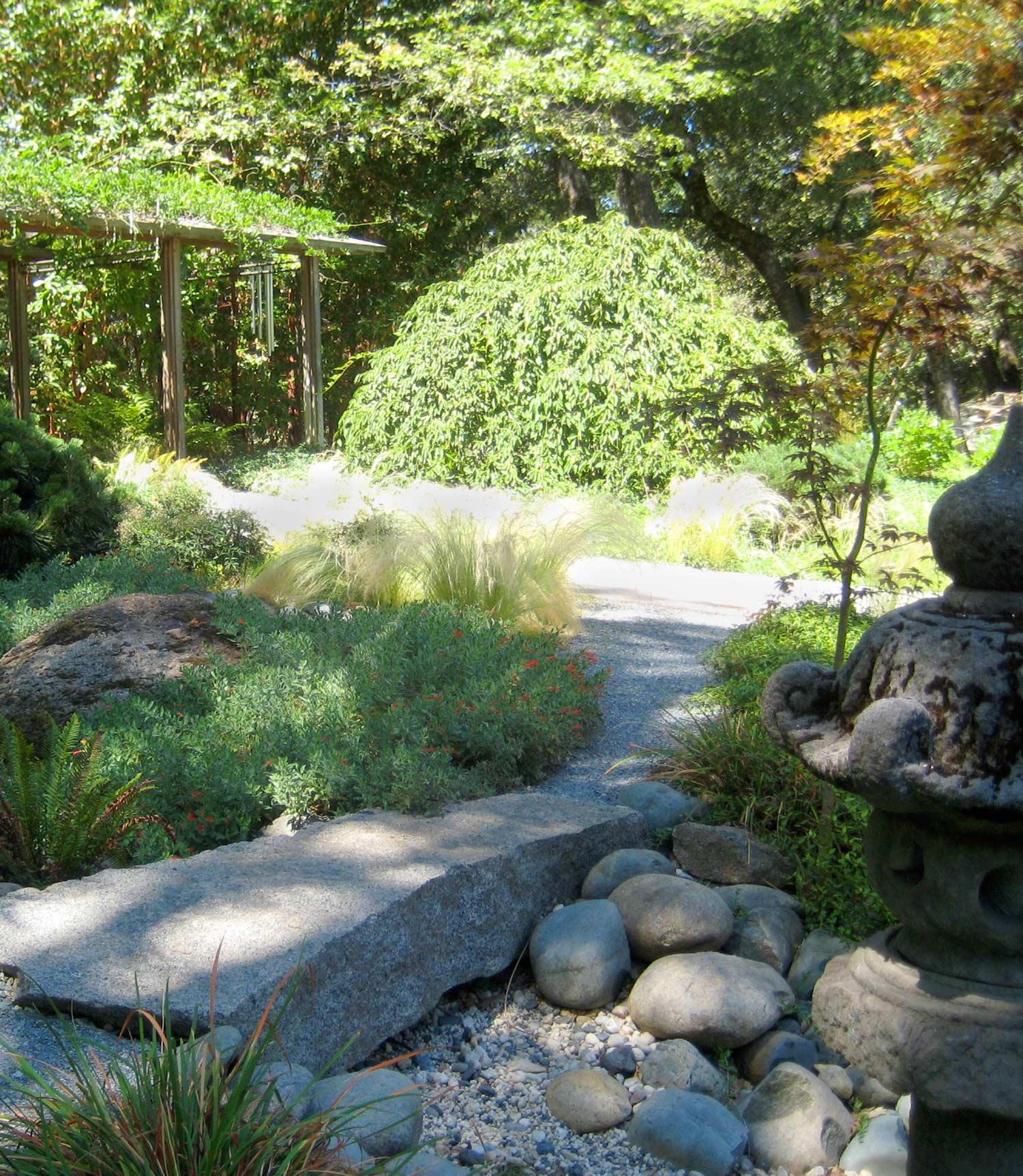 Stone bridge in a woodland garden