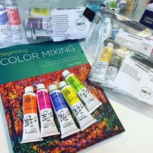 KA Holb oil paints and book.jpg