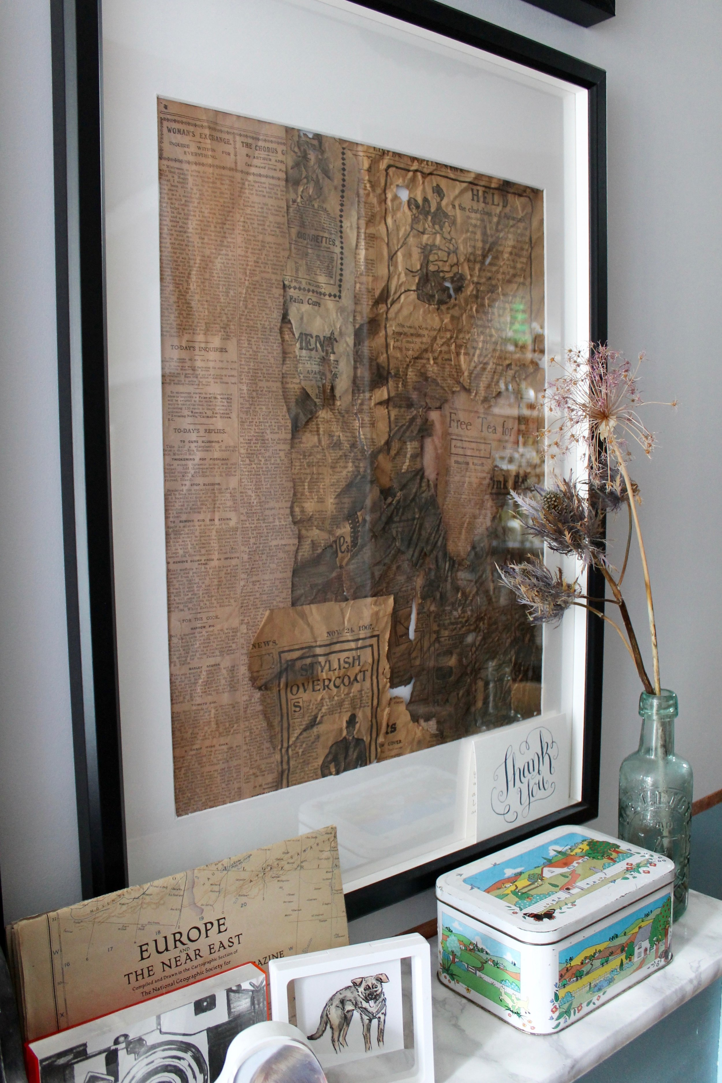 Photography provided by Joanna Thornhill - Framed newspaper scraps also found under the floorboards during renovations.