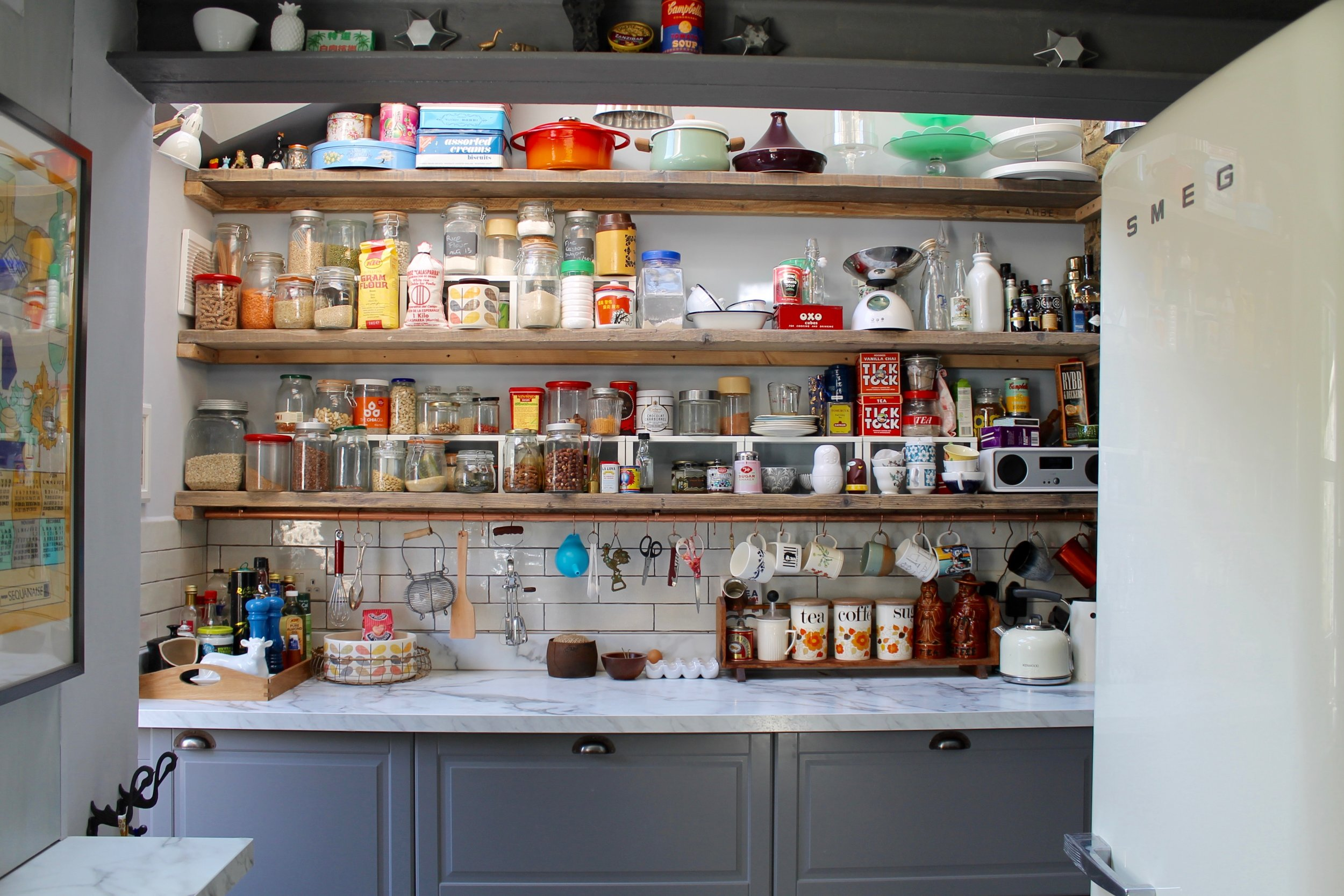 Photography provided by Joanna Thornhill - New kitchen extension integrates   into the period style of the house by bringing in warmth with old scaffold boards as shelving, a copper hanging rail and vintage styling as well as leaving some of the old brick and beams exposed