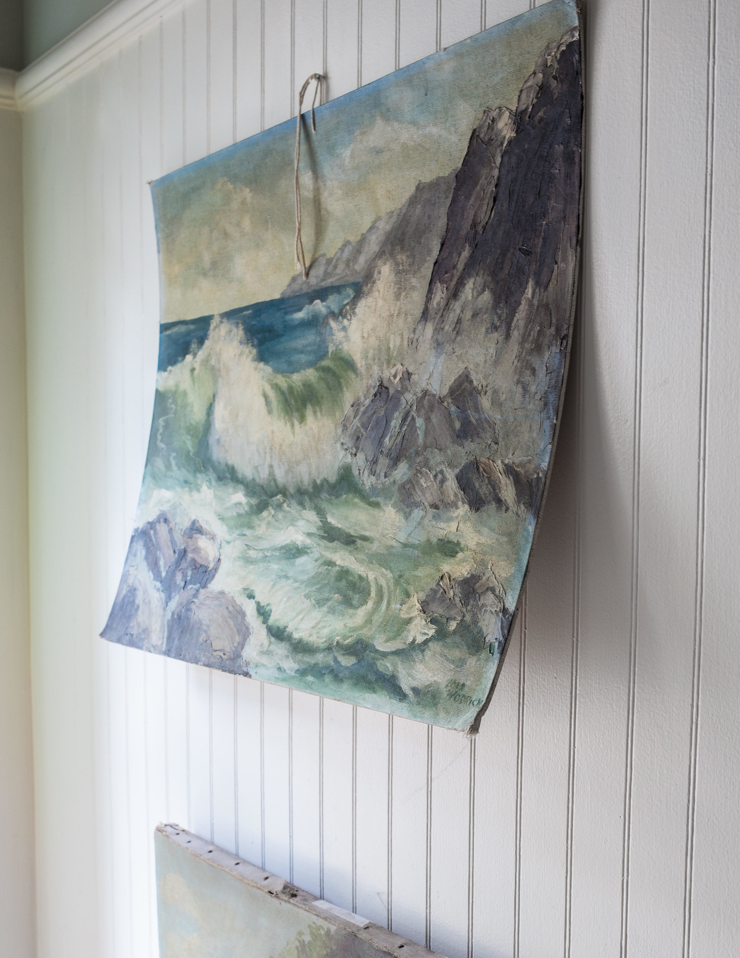 Inexpensive piece of art, probably painted by a student, found in an antiques shop and hung casually with a piece of string can be the best thing for your walls! Photo by  Becki Griffin .