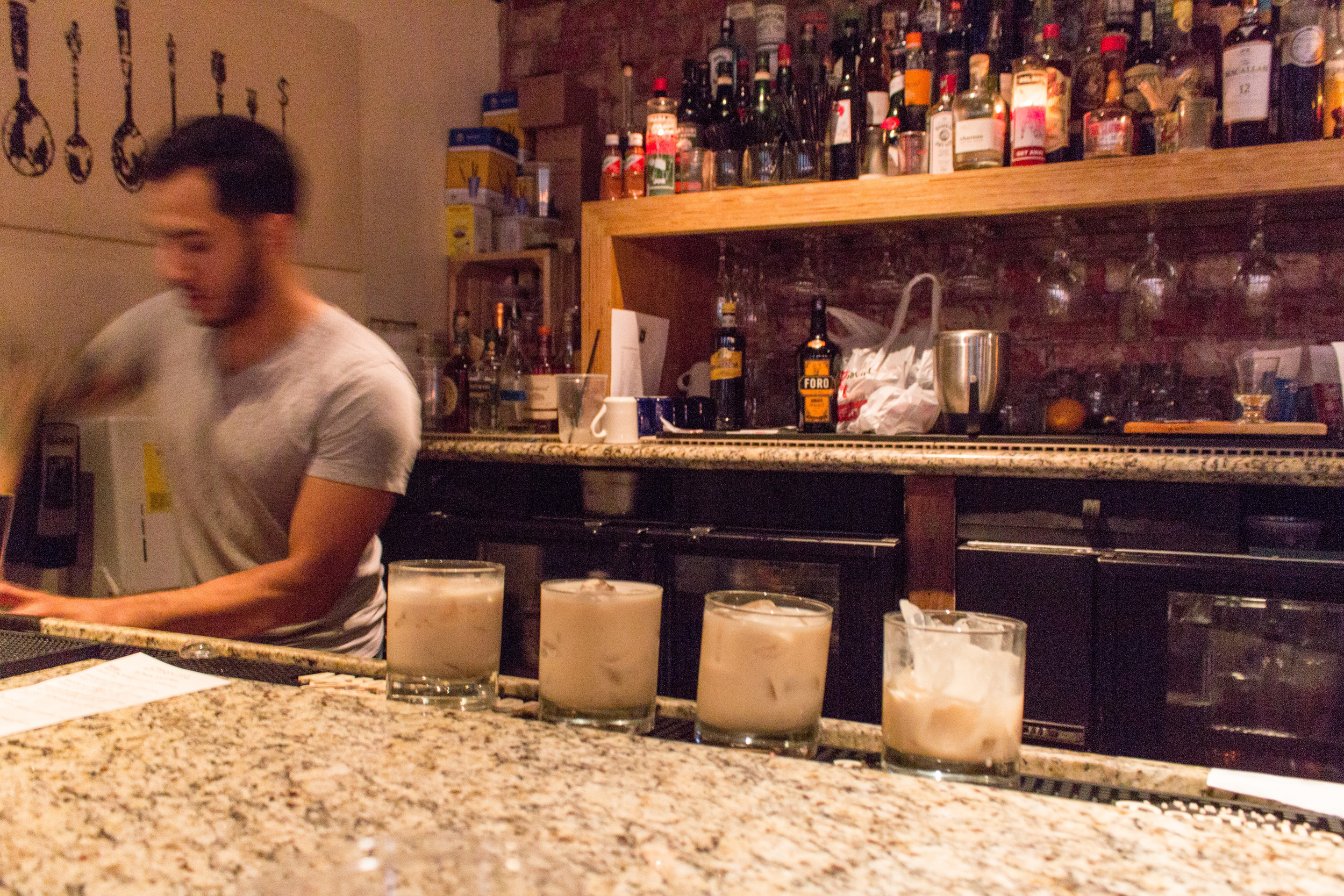 Bartender prepares BorraChata cocktails- yes, a mix of rumwith the most popularagua fresca - house rum blend, horchata, cream, canelasyrup, huevo.