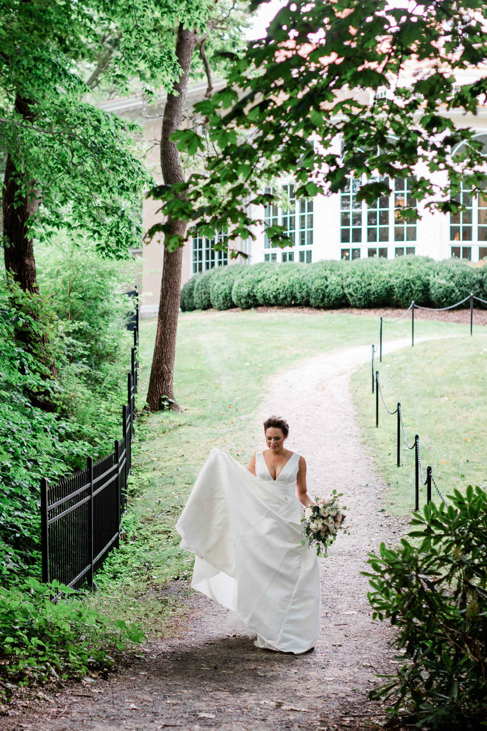 Bride walking to first look at Tupper Manor