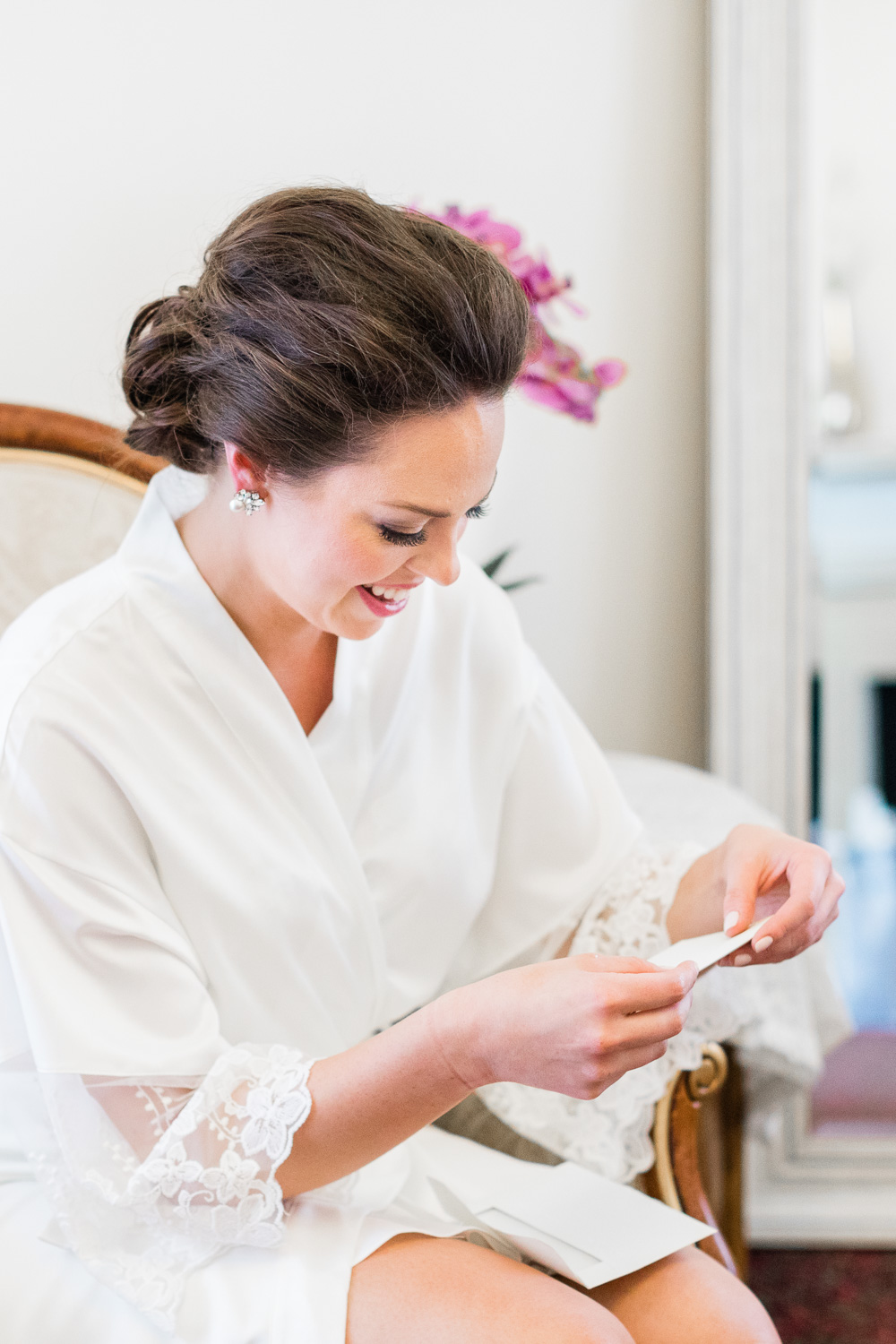 Bride Smiling while reading letter from future husband