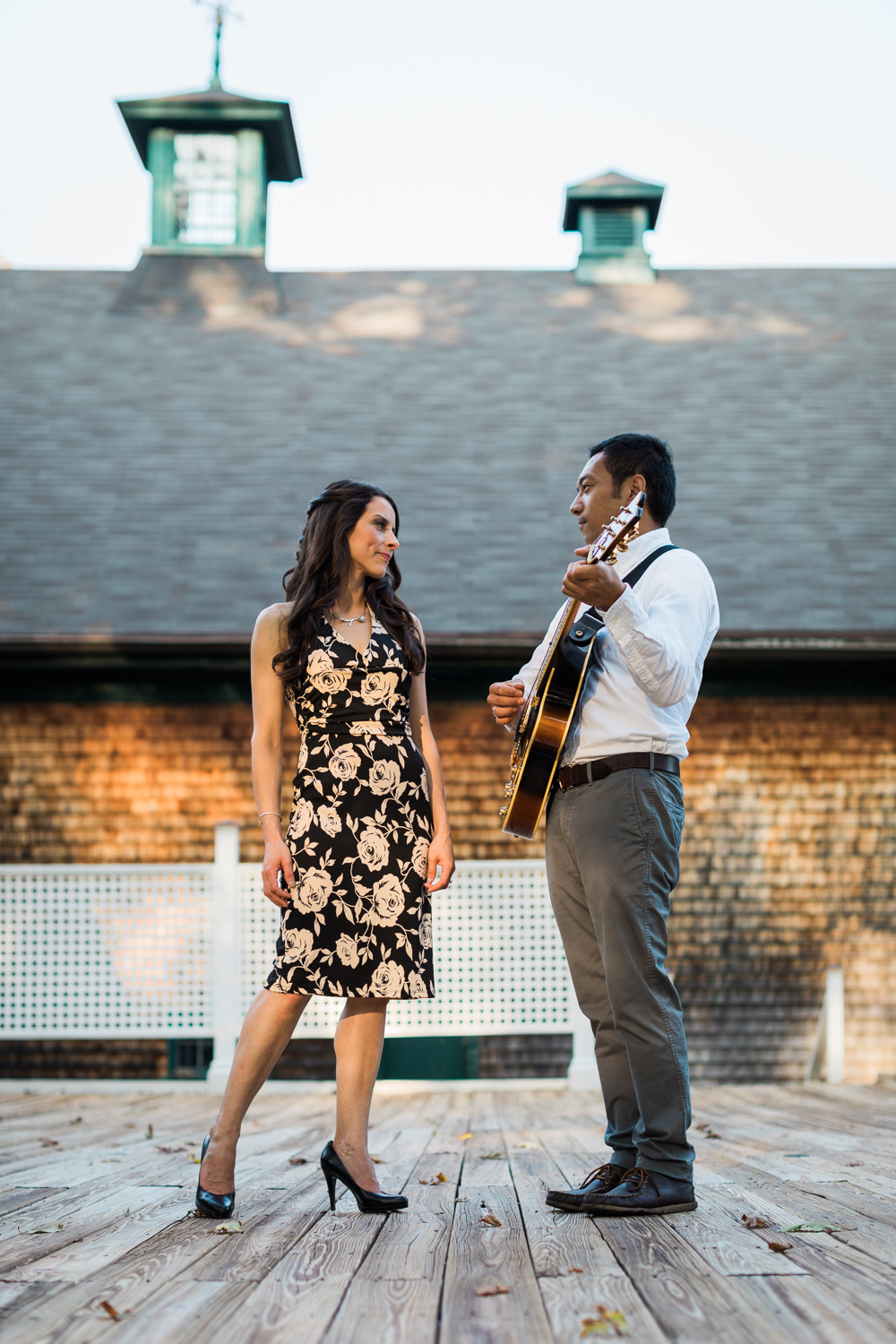 Couple serenading with guitar engagement session