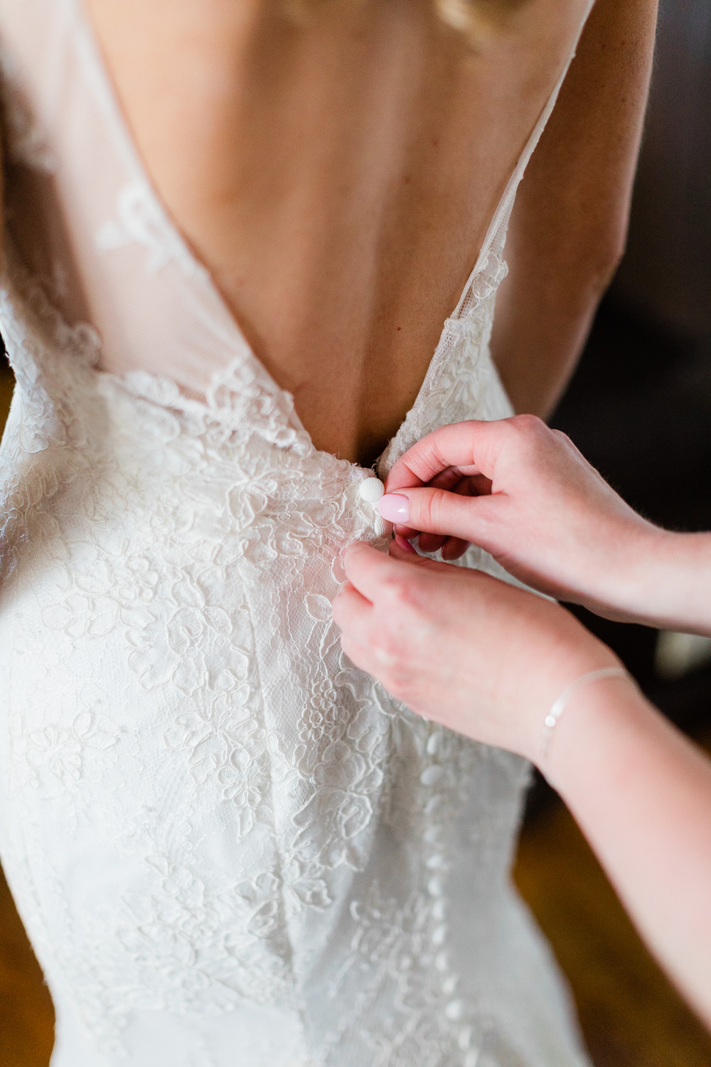 Bride putting on her dress in Shining Tides