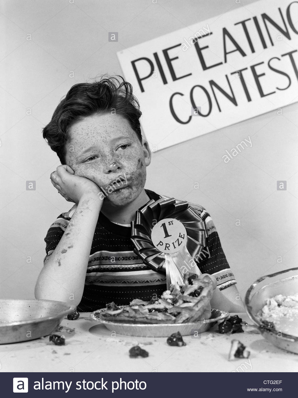 1950s-boy-wins-1st-prize-at-pie-eating-contest-and-looks-sick-CTG2EF.jpg