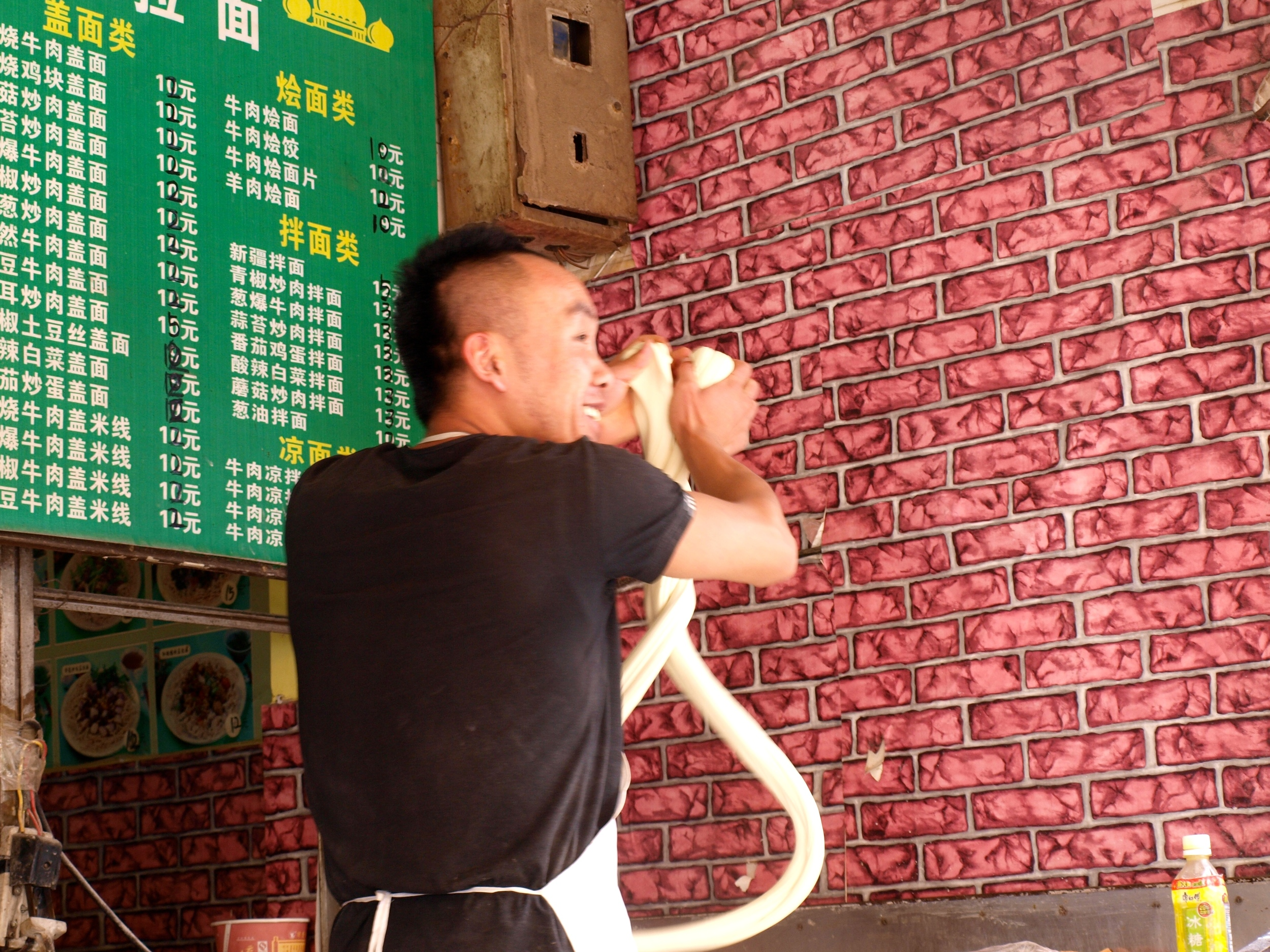 A Uyghur Making läghmän لەڭمەن In Kunming, Yunnan.