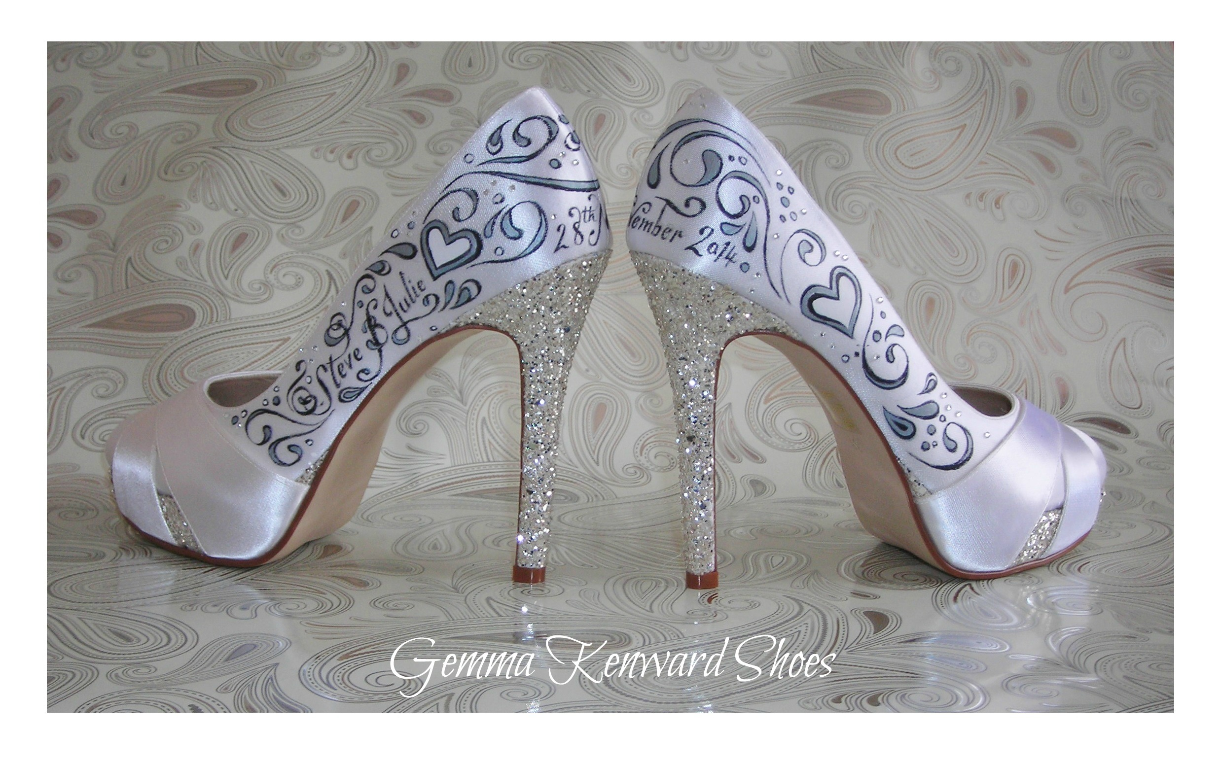 Hand painted shoes personalised with the names, date of the wedding and tiny diamantes! (pain stakingly applied to the shoes with a steady hand and tweezers, may I add!