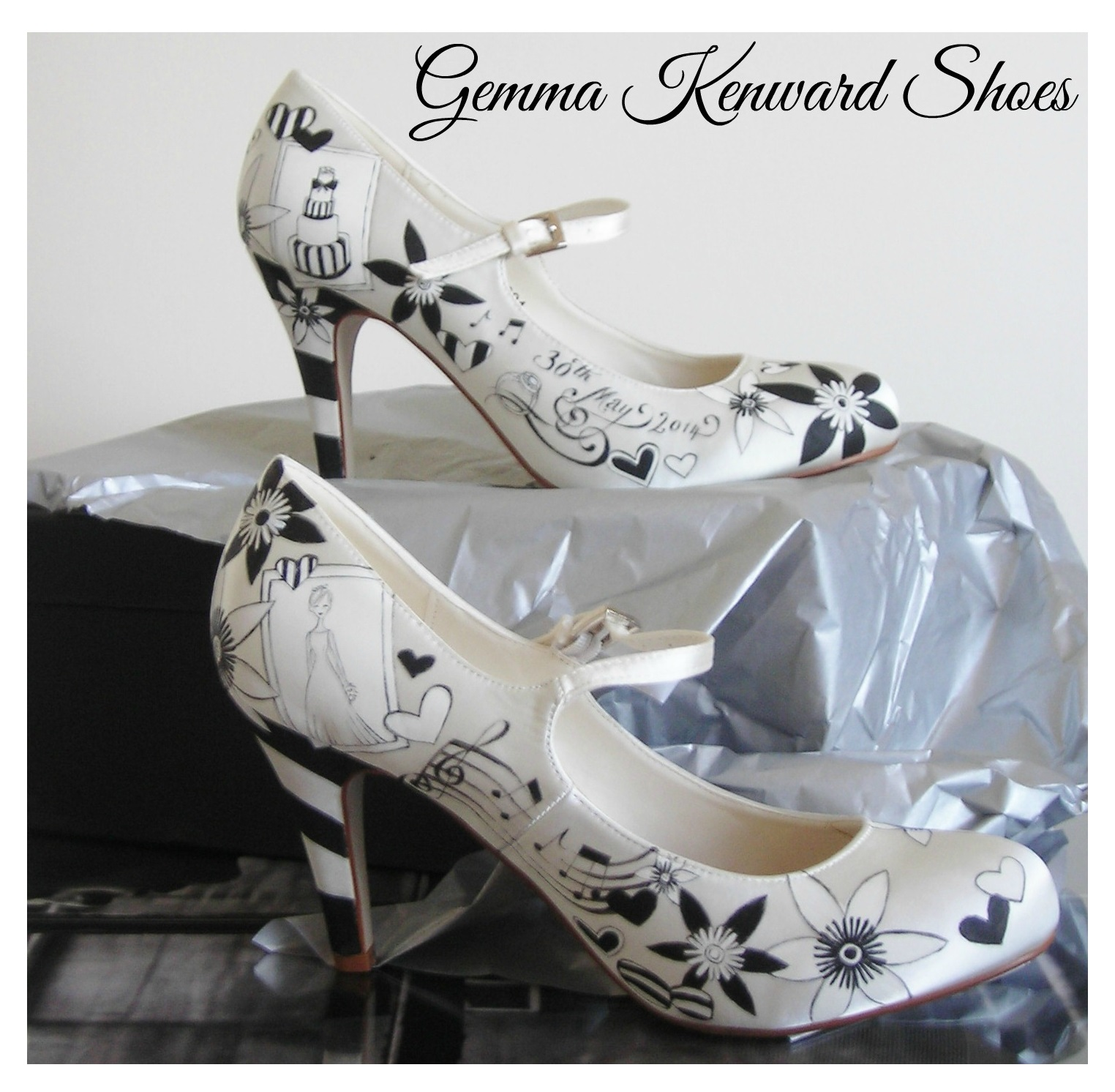 Hand painted black and white stripey wedding shoes with paper flowers.