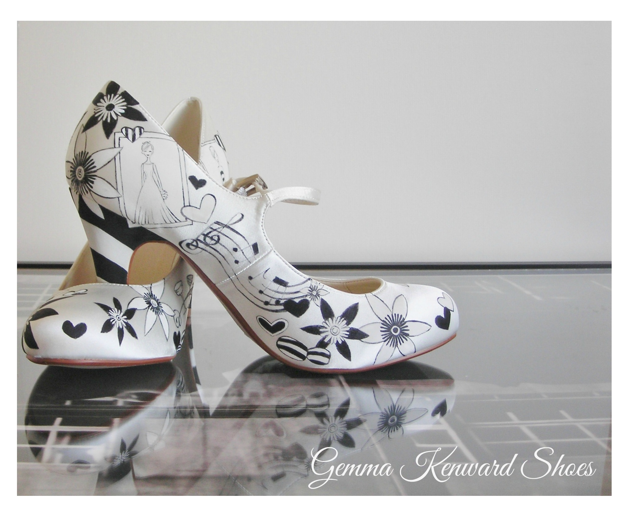 Hand painted wedding shoes with humbug sweets, musical notes and flowers - can you spy the gorgeous brides wedding dress?