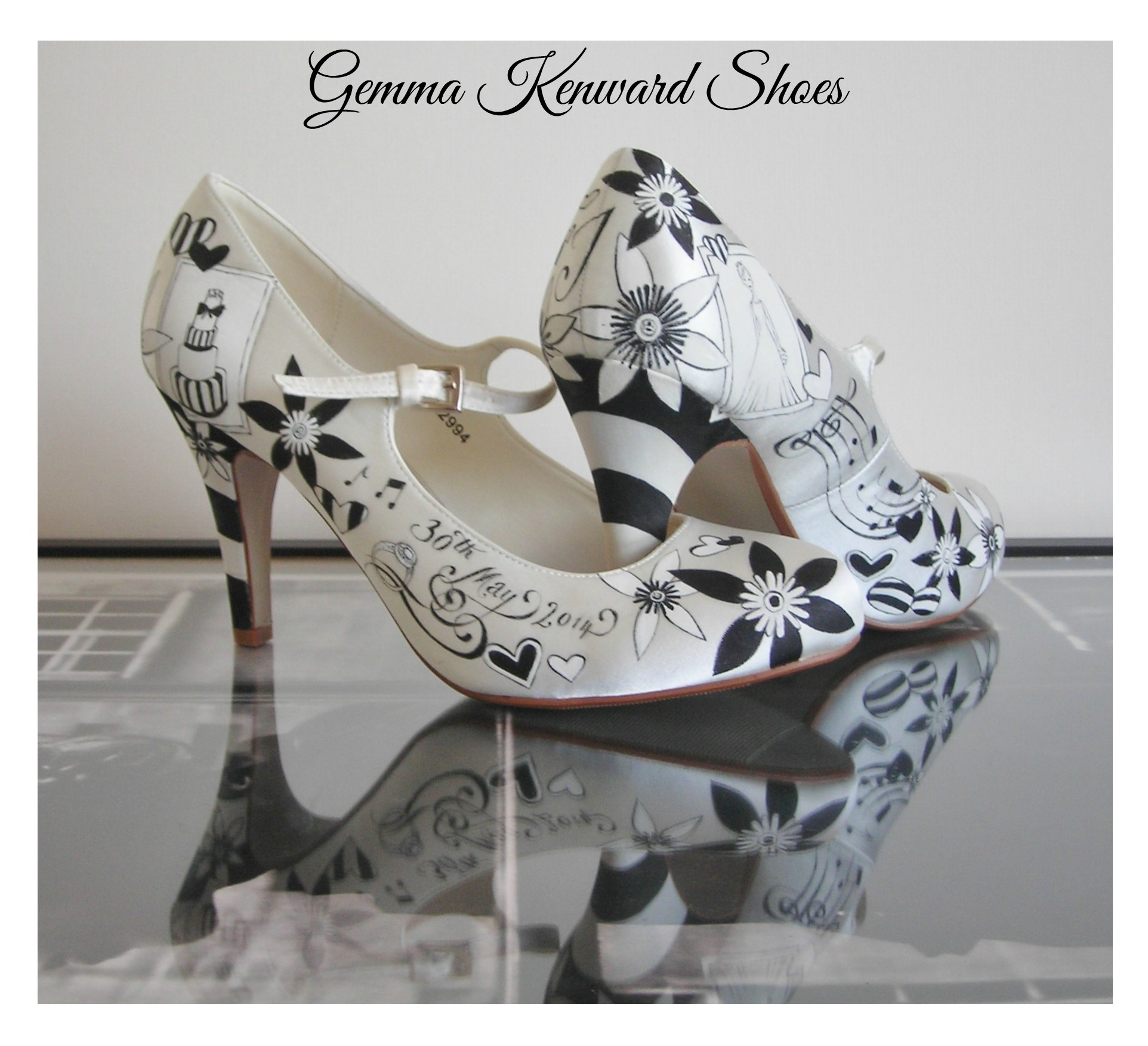 Hand painted wedding shoes with a black and white stripey heel.