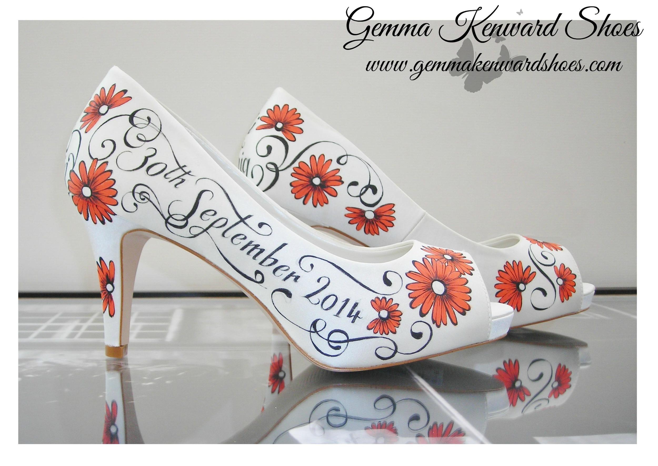 Orange gerberas hand painted onto a pair of custom wedding shoes