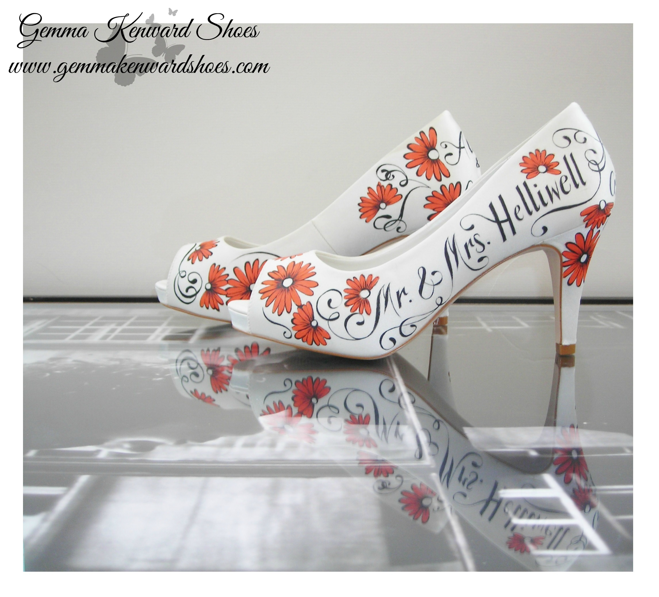 Orange gerberas hand painted onto a pair of personalised wedding shoes