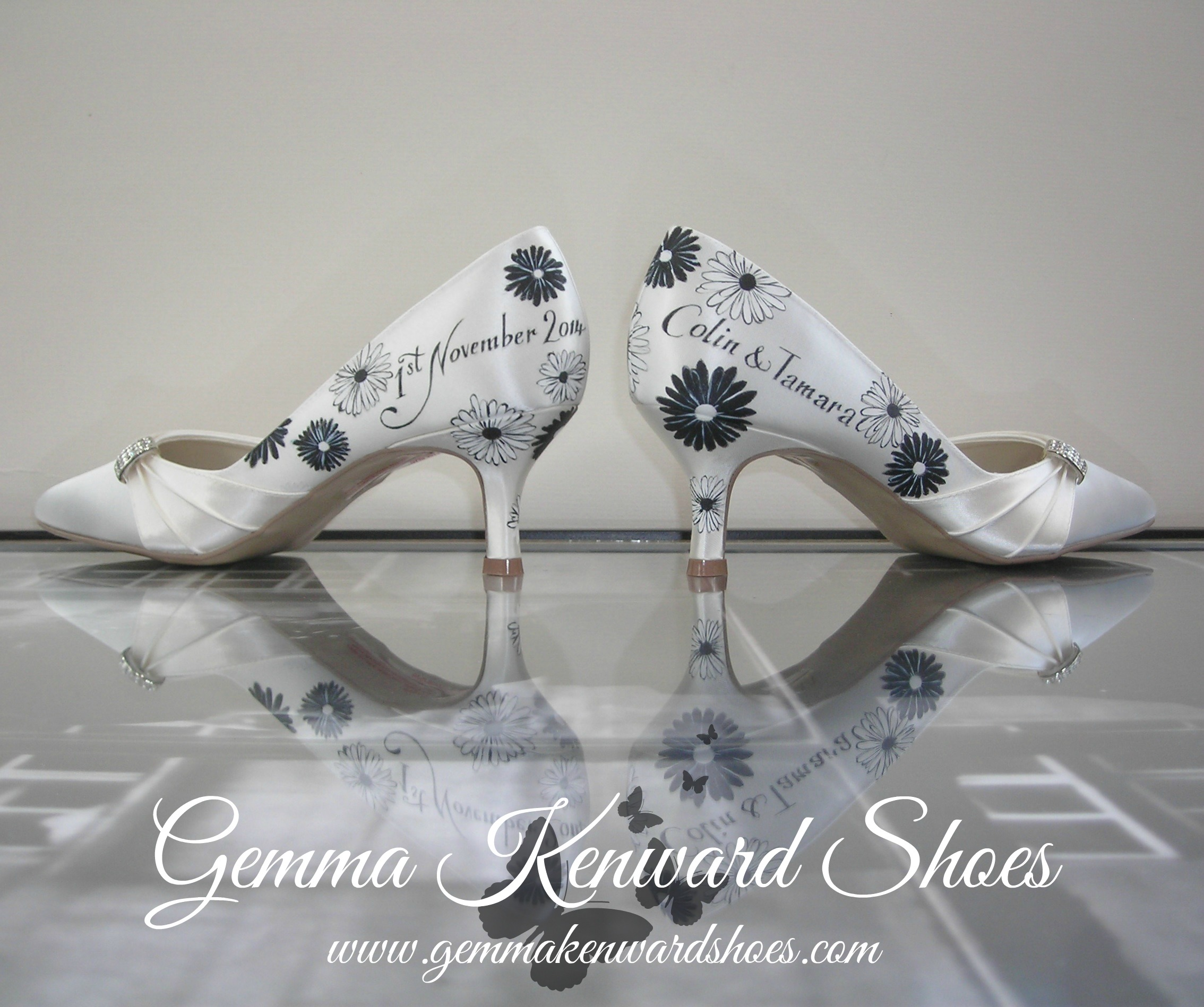 Black and white gerberas on a pair of custom hand painted wedding shoes