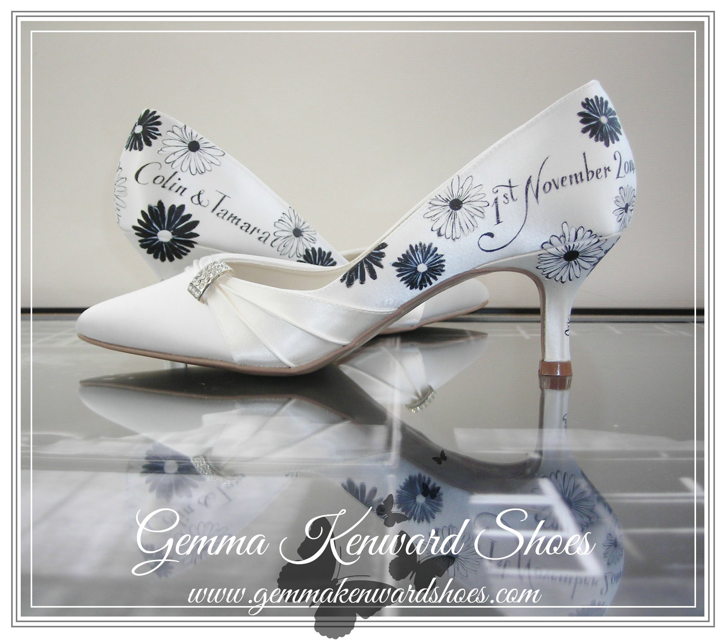 Black and white gerbera flowers hand painted on a pair of personalised wedding shoes