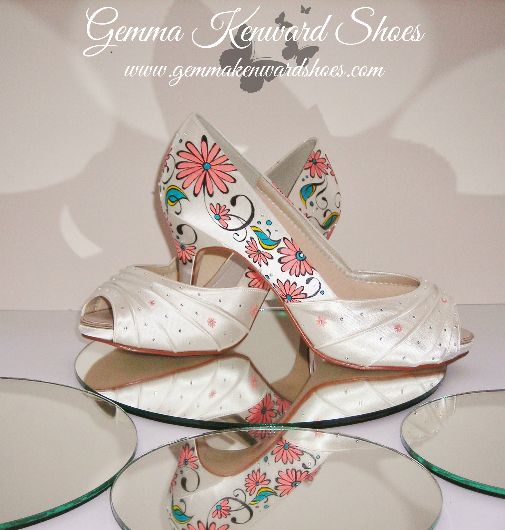 Pink gerberas on a pair of wedding shoes