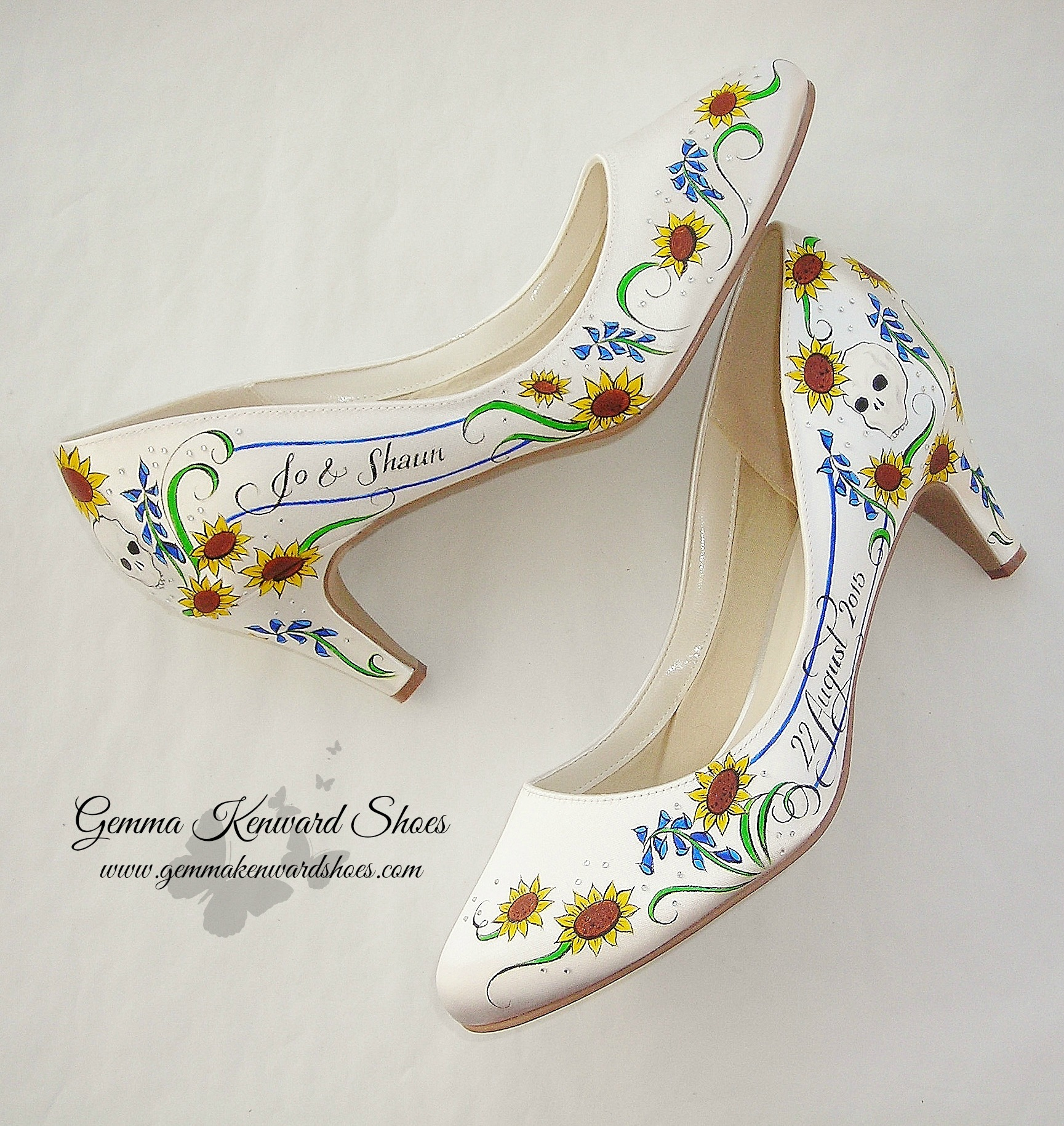 Personalised bridal shoes for a bride with flowers and skulls, adorned with diamonds / diamantes