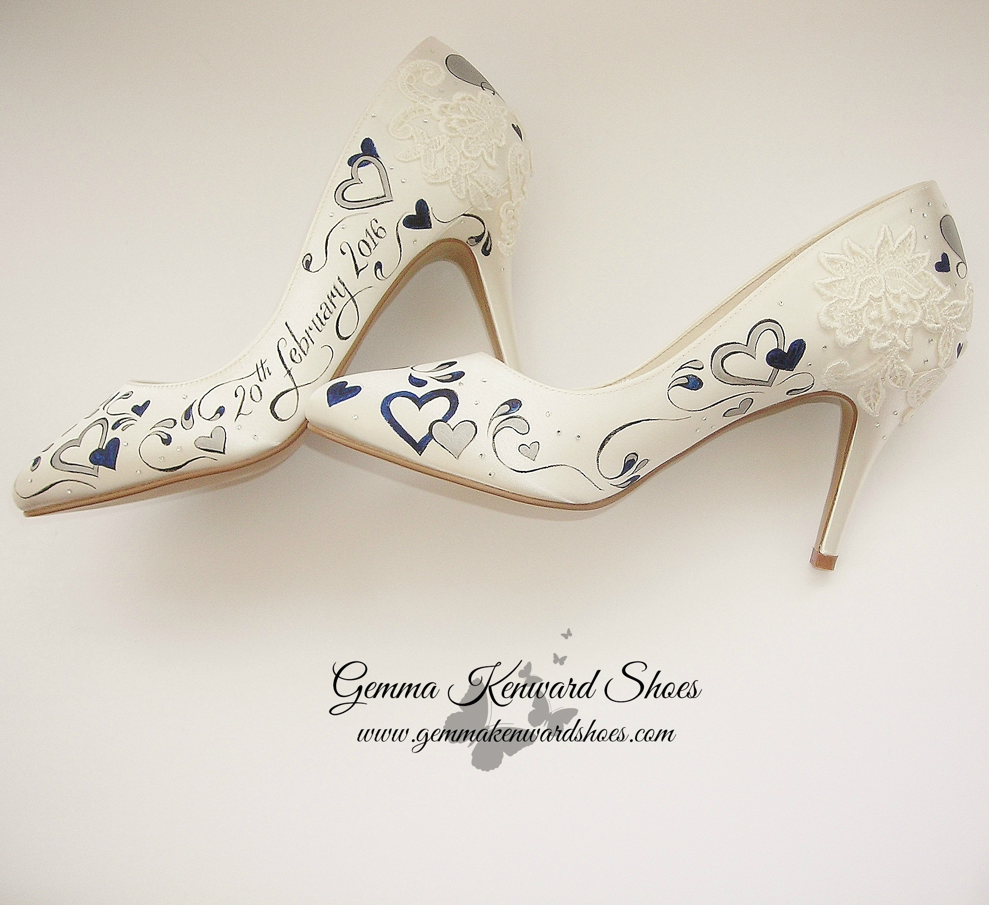 Hand Painted navy and silver hearts with applique lace added to the design for one of our beautiful brides.