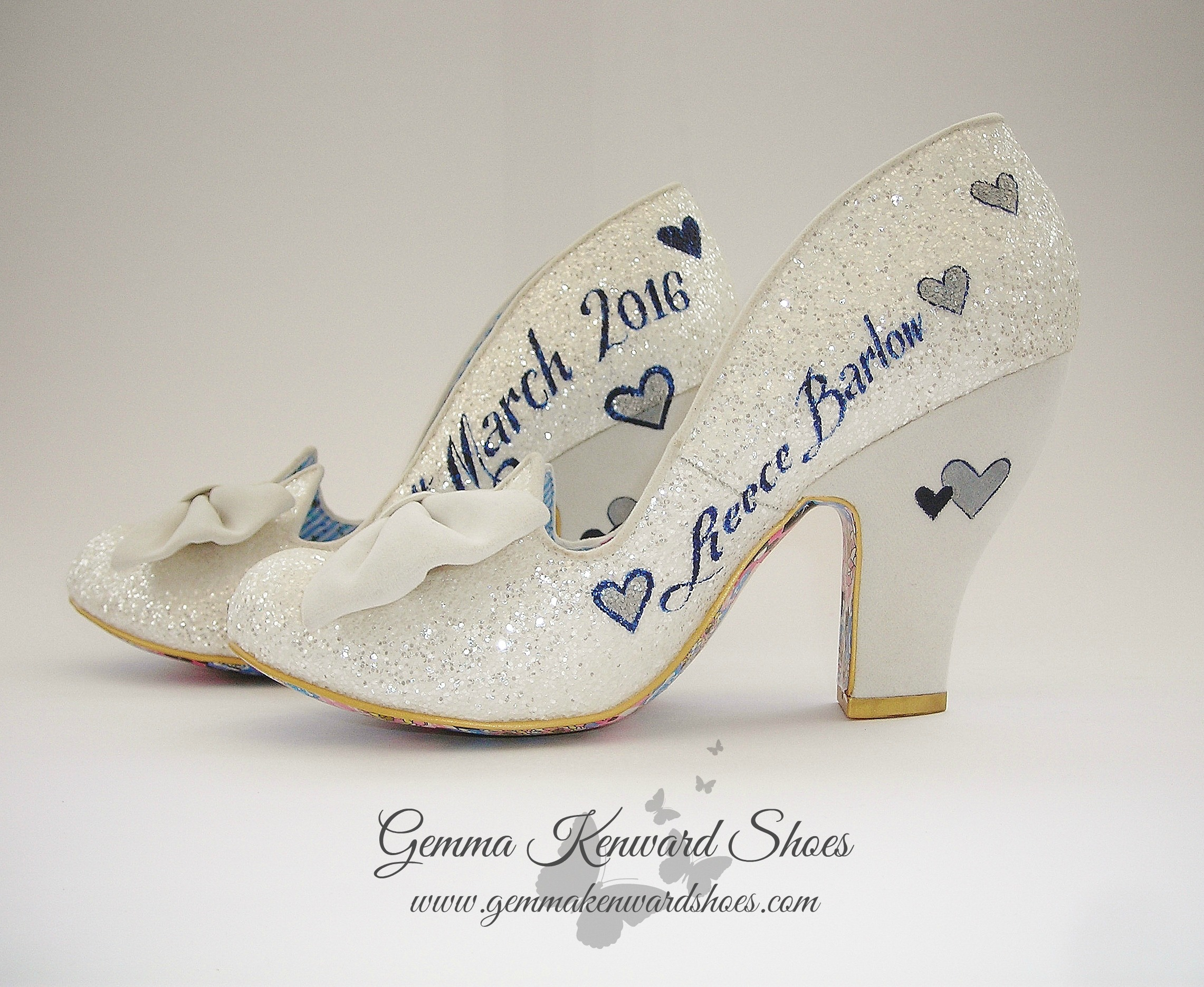 Bows on Irregular Choice wedding shoes painted with navy and silver hearts, names and date