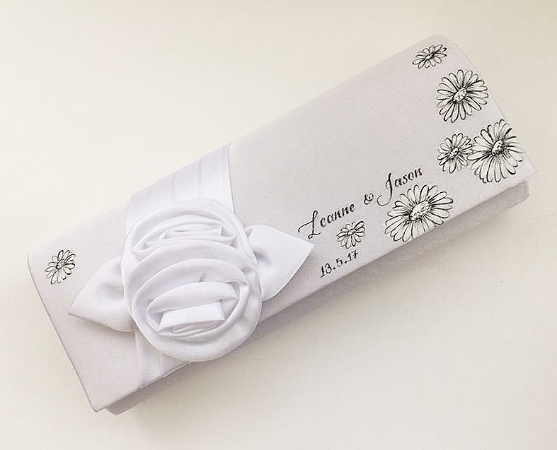 Black and white gerberas customised for a brides wedding clutch bag