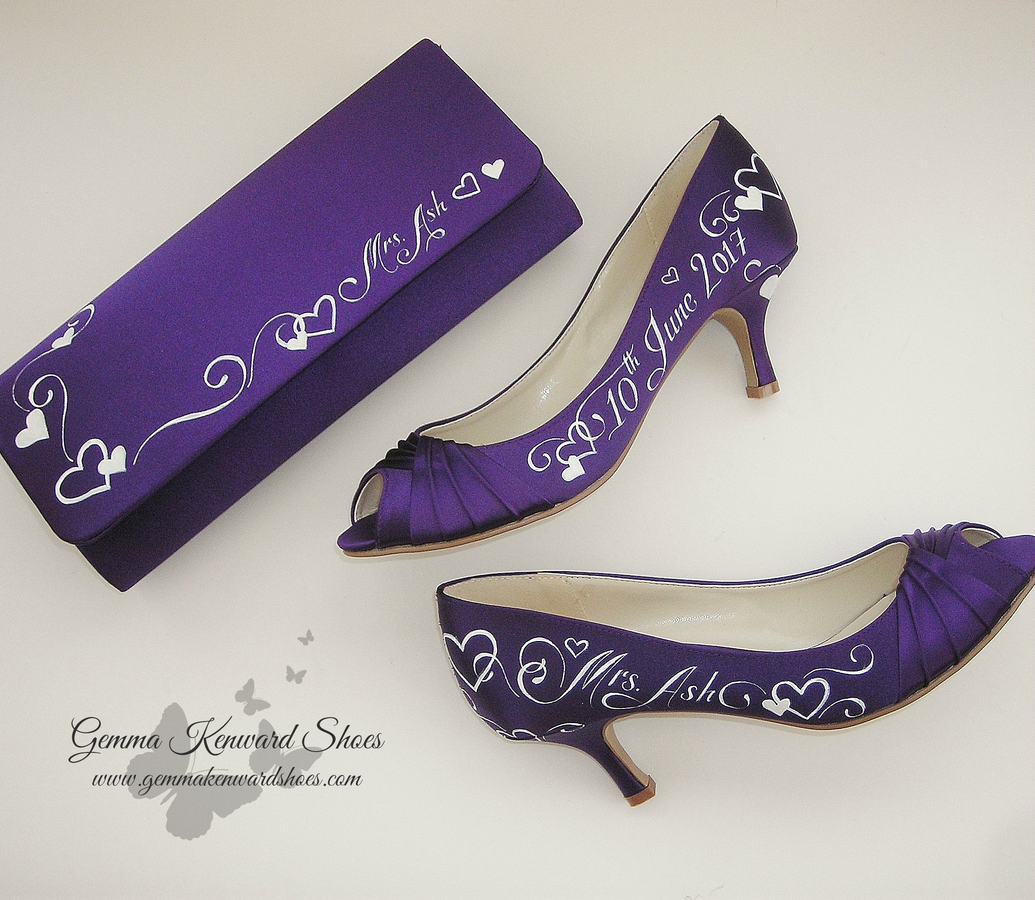 Cadbury purple hand painted wedding clutch bah with white hearts and wording
