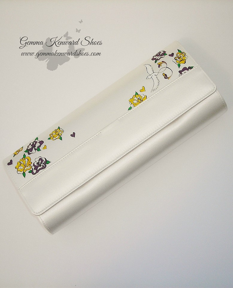 Hand painted yellow and purple roses and birds on a brides clutch bag