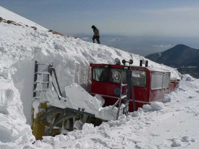 cog railway removing snow, operating in April to late June depending on the weather