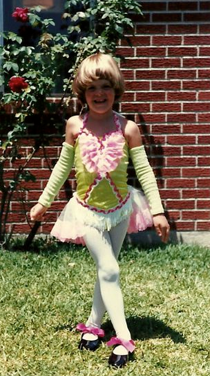 Posing for a picture before my tap recital. This was one of my favorite costumes.