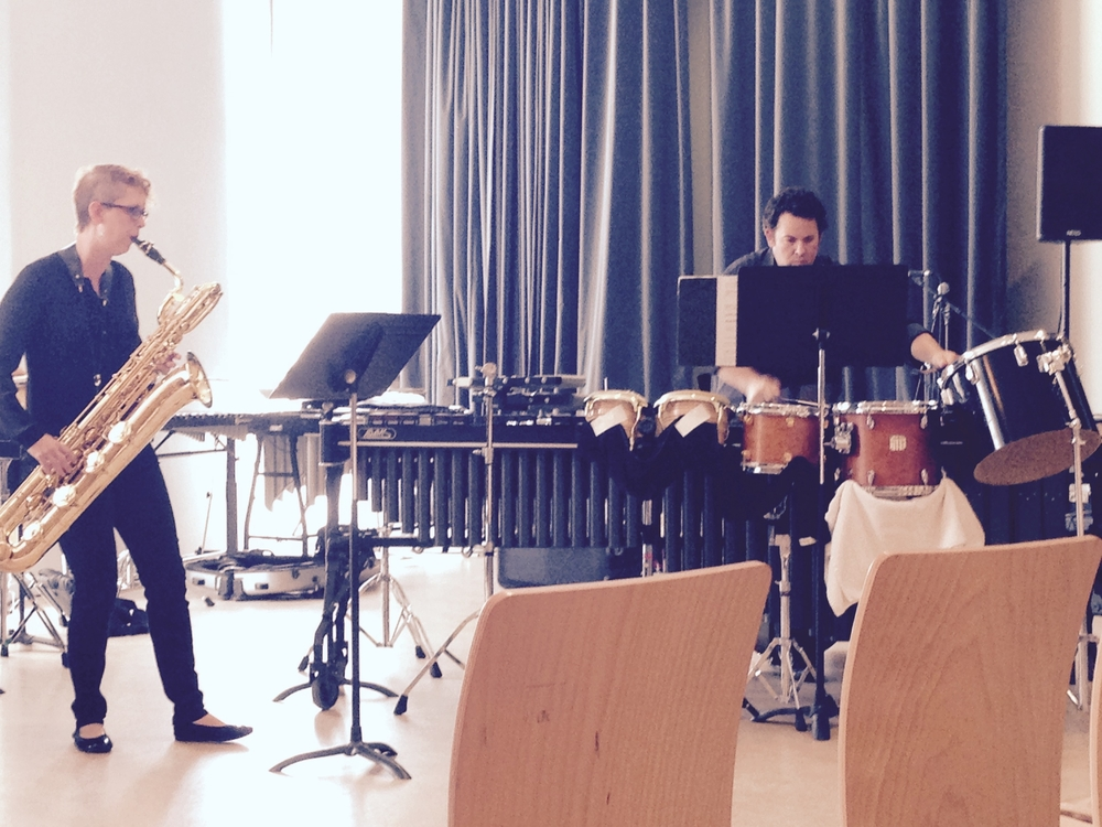 Adrianne and Jeff perform zac's duo for baritone sax and percussion in france.