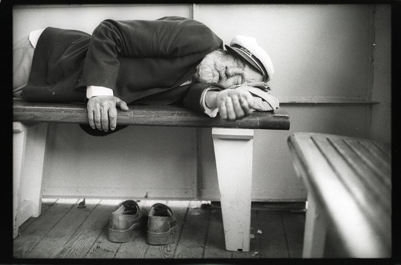 Man Sleeping on boat in Venice, Italy