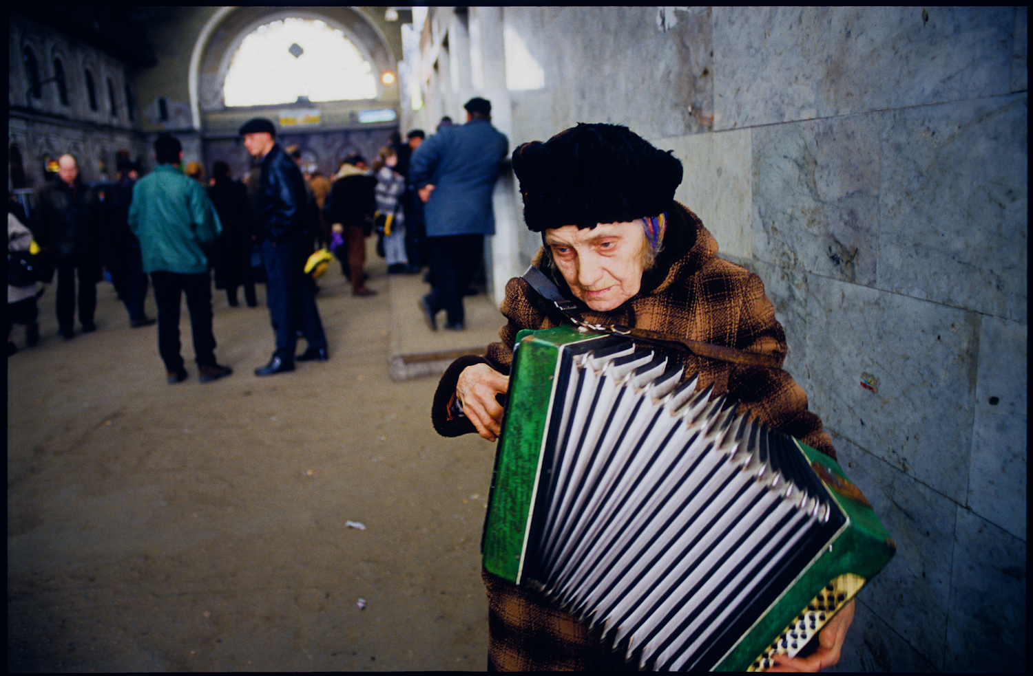 St. Petersburg, Russia. Anna Kuznetsova playing her accordian at the  Baltisky train station to augment her monthly pension of 800 rubles (23  dollars) per month.