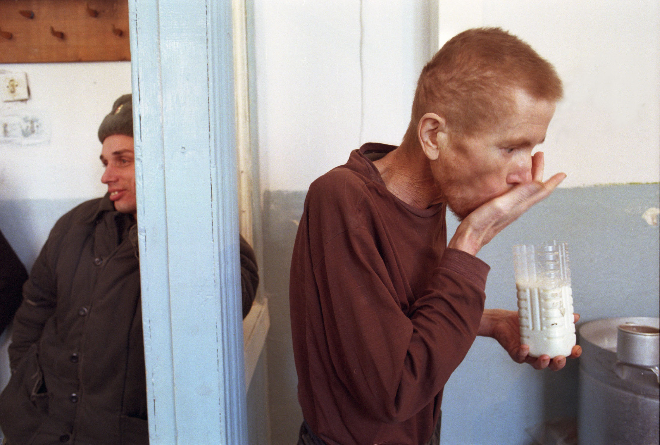Mariinsk, Russia. An inmate receives medication for tuberculosis at the  #33  Prison Colony.
