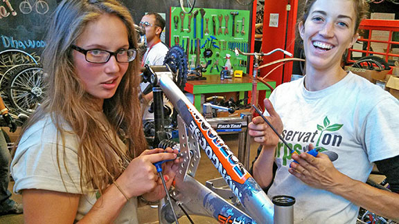 Photo: YO crew leaders Zola Pineles (left) and Jane Dunlap repaired a bike at Spokes in Minneapolis.