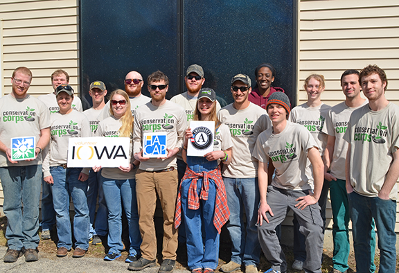 Iowa corps members celebrated Solar Day in front of the home installation in Cedar Rapids.