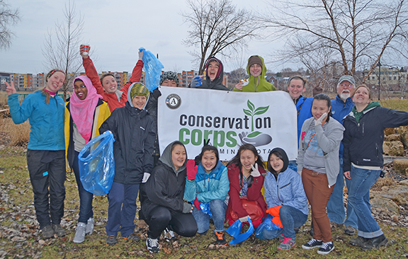Youth alumni, volunteers and Corps staff members kicked off the Harriet Island cleanup.