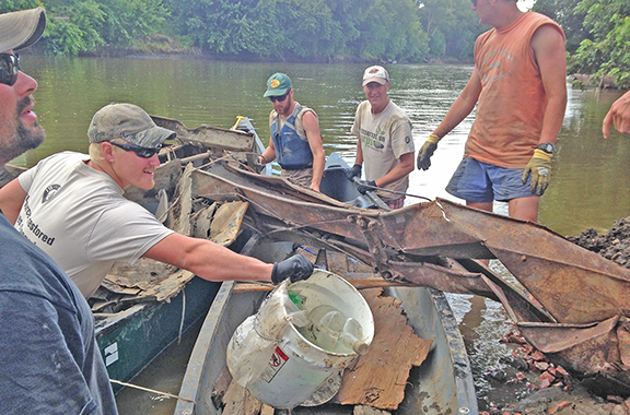 Conservation Corps crew and staff members worked with volunteers to clean up the Big Sioux River during Project AWARE.
