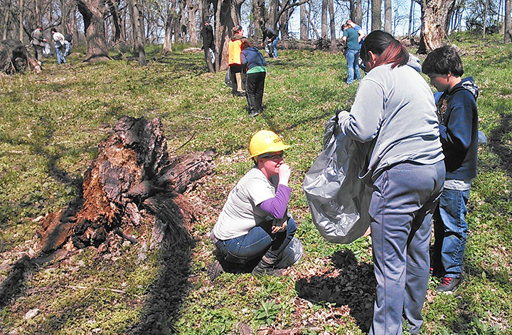 Bre Hess-Fross workedwith volunteers to remove invasive plants in Polk County.