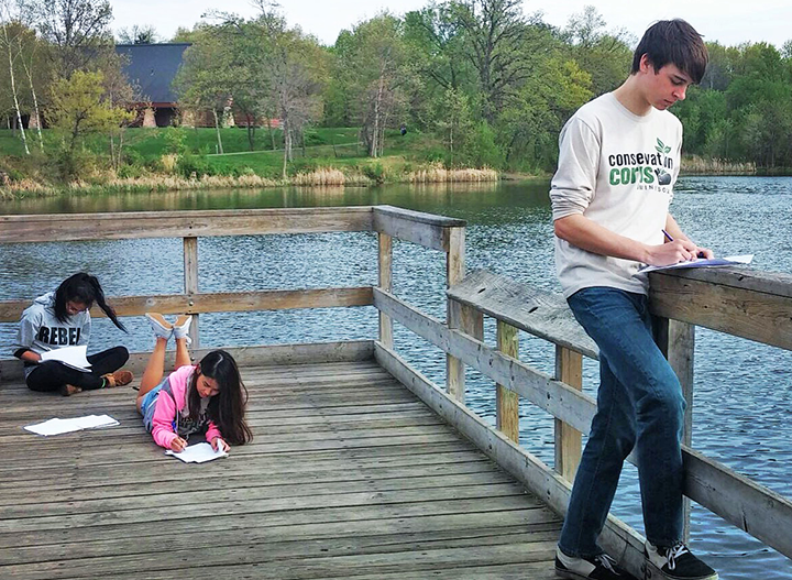 El Rio Vista youth writing about what they are experiencing at Thompson Regional Park.
