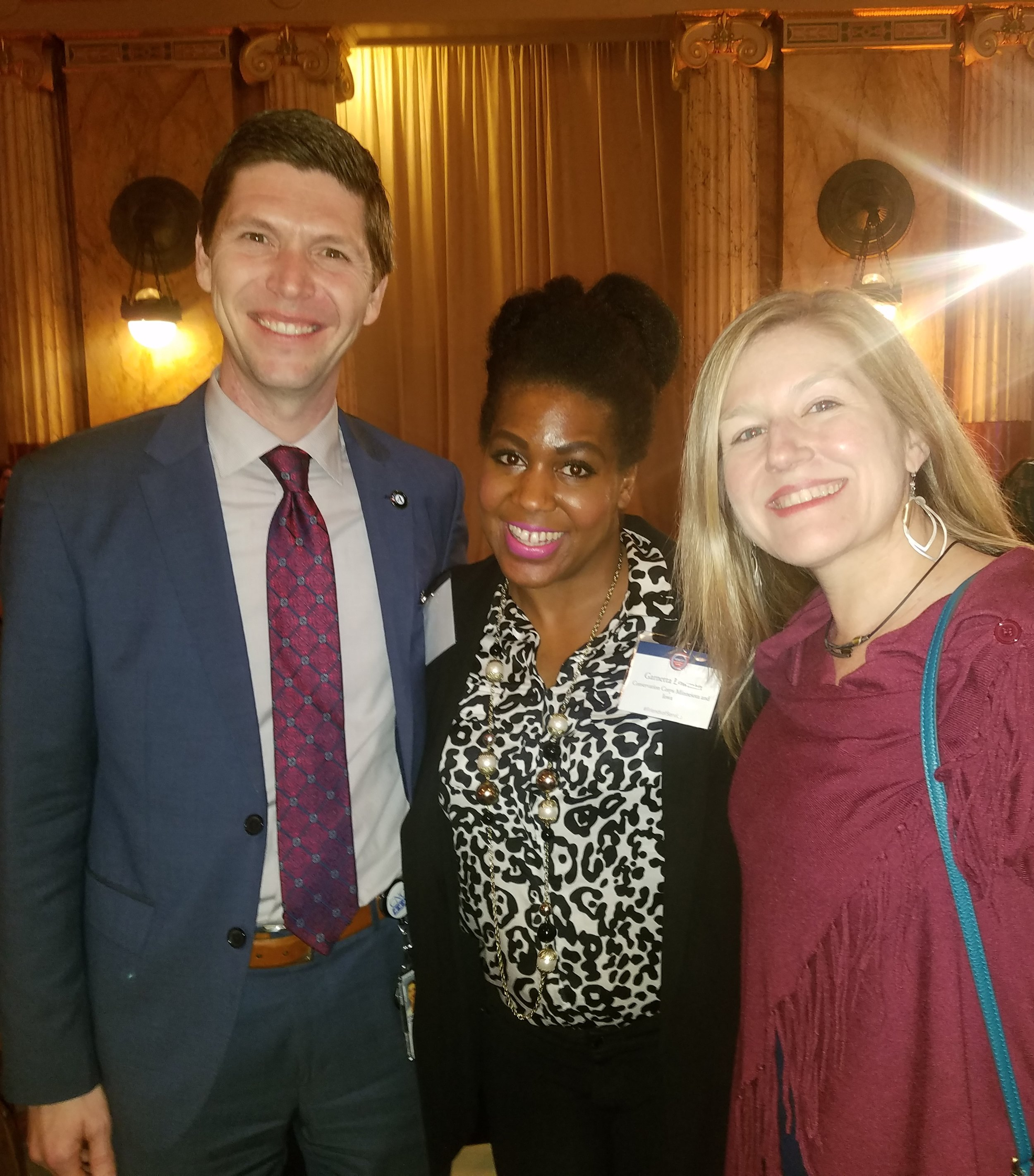 BUILDING CONNECTIONS: Director of AmeriCorps Chester Spellman, of the Corporation for National and Community Service, visited with staff during the Voices for National Service Awards event.