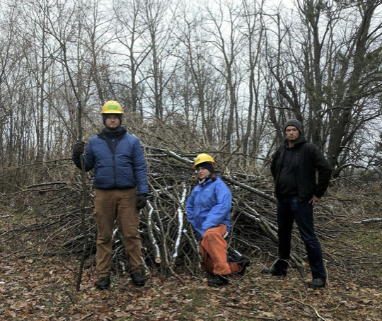 Conquered brush pile after a day of cutting and removing invasive Siberian Peashrub.