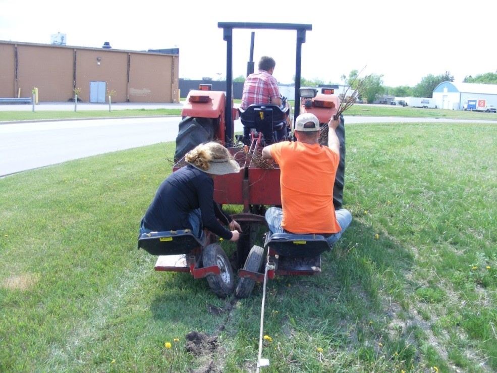 Planting trees with Peter Nelson and Levy Bergstrom from the Pennington SWCD office.