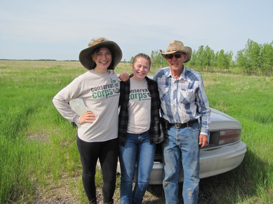 Conservation Corps Apprentices chatting with a WRP easement landowner.