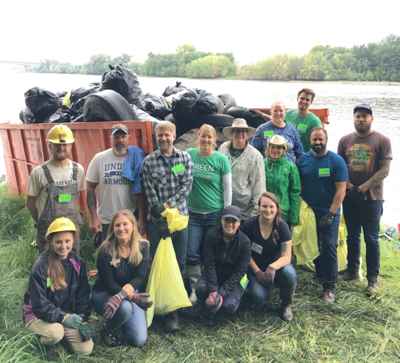 Volunteers, staff, and AmeriCorps members worked hard to fill this dumpster with over 2 tons of trash collected from the shoreline areas of the Mississippi River.