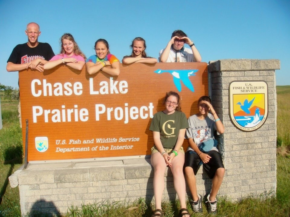 Margaret with her Summer Youth Corps crew at the entrance to the Chase Lake Prairie Project in 2012.